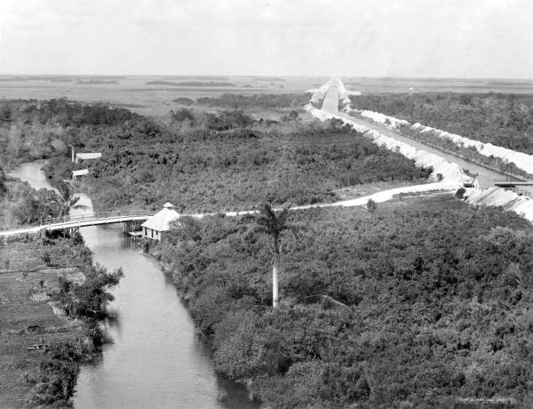 Reclaiming the Everglades, the Miami River is on the left and with the canal to the right, Jan. 29, 1912 (State Archives of Florida)